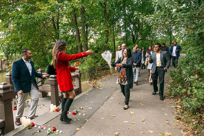 Family and friends congratulate newly engaged couple Central Park
