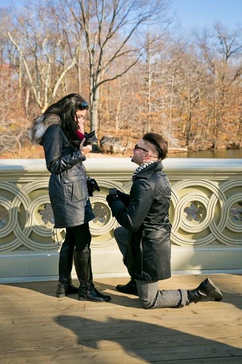 Girlfriend surprised as boyfriend proposes on one knee on Bow Bridge