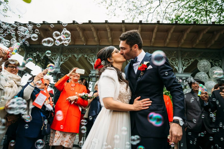 Guests blow bubbles for newlyweds in front of Ladies Pavilion